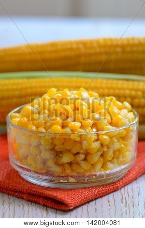 Yellow steamed corn in a bowl, close up