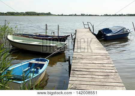 Boats in the bay of Nature reserve Neuendorfer Wiek at Neuenkirchen on the island of Ruegen. Germany