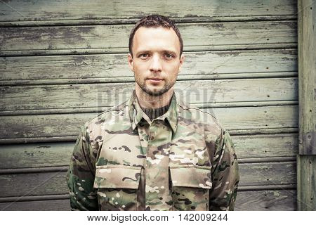 Caucasian Man In Camouflage Uniform