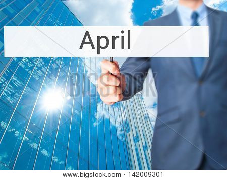 April - Business Man Showing Sign