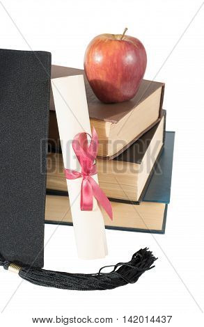 Black graduate hat stack of big books red apple and paper scroll tied with red ribbon with a bow isolated on white background
