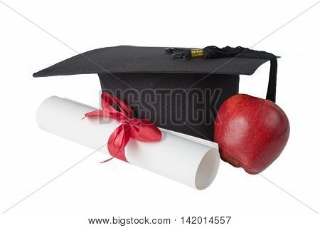 Black graduate hat red apple and paper scroll tied with red ribbon with a bow isolated on white background