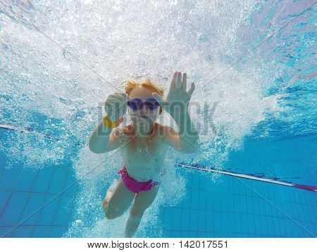 child swim in the pool