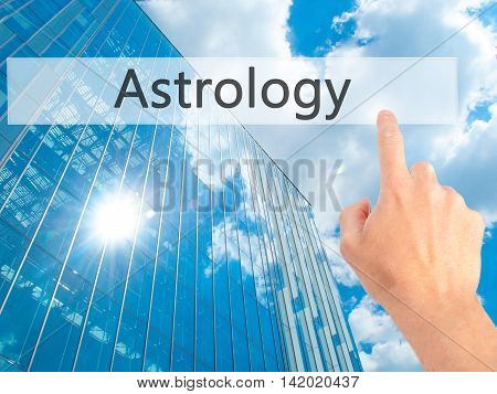 Astrology - Hand Pressing A Button On Blurred Background Concept On Visual Screen.