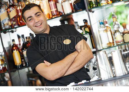 Barman worker standing at bartender desk