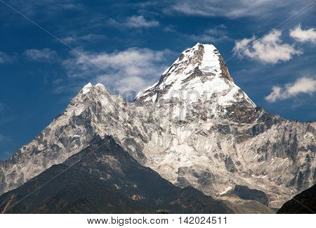 View of mount Ama Dablam on the way to Everest Base Camp with beautiful cloudy sky Sagarmatha national park Khumbu valley Nepal