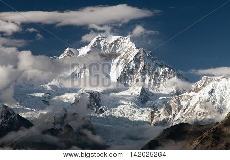 Evening view from Gokyo Ri to mount Gyachung Kang 7952m within clouds near Cho Oyu way to Cho Oyu base camp three passes trekking route Gokyo valley Sagarmatha national park Khumbu valley Nepal