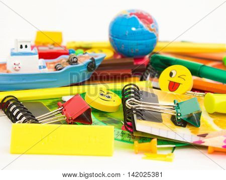 Pens, pencils, erasers with emoticons, a set of notebooks. Schoolchild and student studies accessories. Back to school concept.