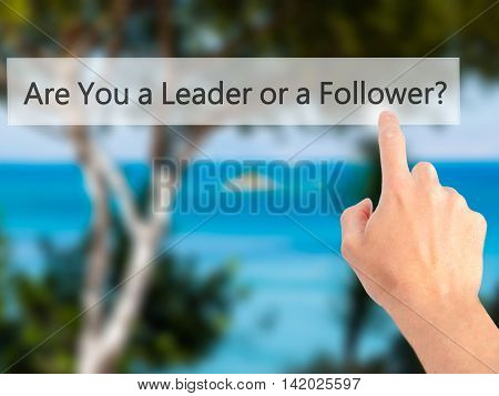 Are You A Leader Or A Follower ? - Hand Pressing A Button On Blurred Background Concept On Visual Sc