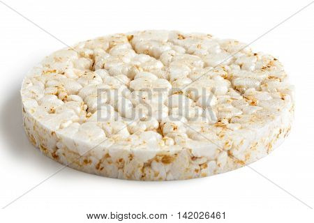 Puffed rice cake isolated on white in perspective.