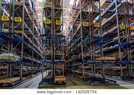 Large storehouse with tall racks full of various wares