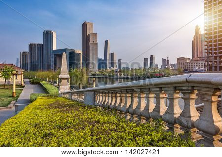 financial district with green beside the road