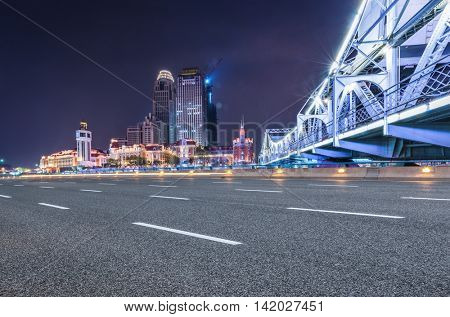 Shanghai Skyline over the illuminated bridg