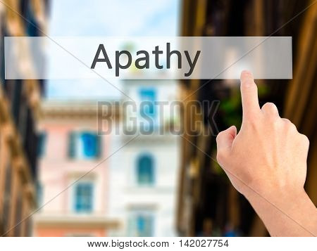 Apathy - Hand Pressing A Button On Blurred Background Concept On Visual Screen.