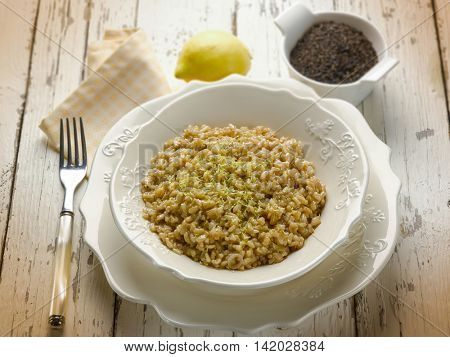 risotto with black tea and lemon peel, risotto with black tea and lemon peel, selective focus