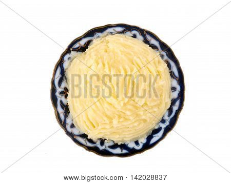 Beautiful plate with mashed potatoes on a white background. View from above