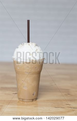 Cappuccino Frappe On Wooden Table
