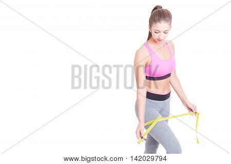 Woman Measuring Her Leg With Tape Line