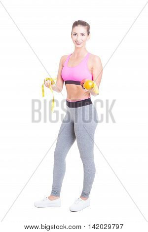 Fit Female Standing Holding Fruits And Tape Line