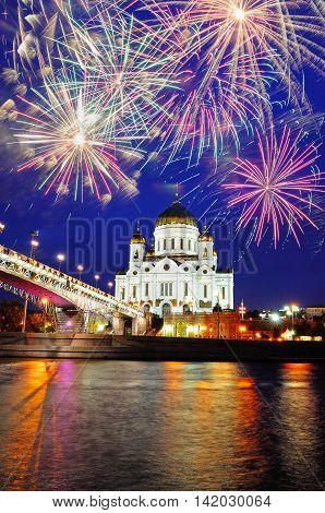 Night Moscow view. Christ the Savior Cathedral and fireworks in the sky in Moscow Russia - colorful night Moscow city landscape with fireworks. Night Moscow architecture. Night city view of Moscow landmark