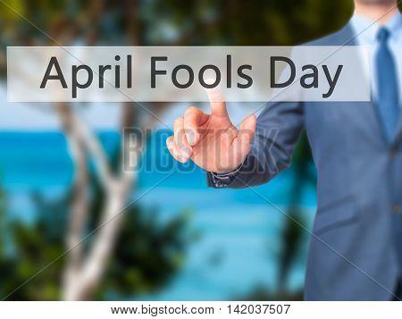April Fools Day -  Businessman Press On Digital Screen.