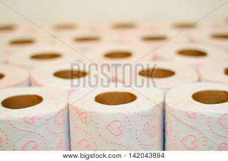 Rolls of toilet paper with heart pictures.