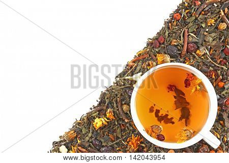 Cup of tea with herbs on white background, top view