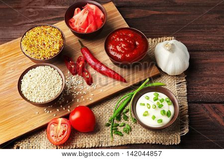Fresh condiments and sauces on sackcloth napkin