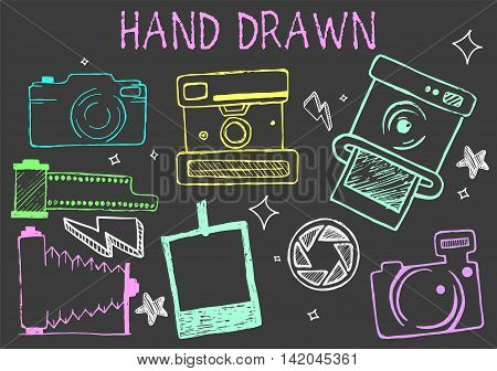 Vector hand drawn chalk illustration of cameras from different times. Photographic equipment set. Black background