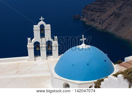 The Three bells of Fira and blue dome, Santorini, Greece