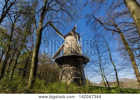 Traditional Dutch windmill in the forest located in Netherlands