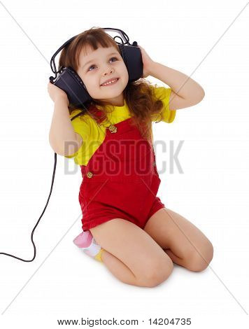 Little Girl Listens To Music