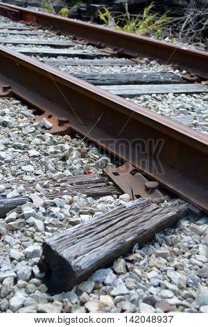 broken rail road ties under rail lines