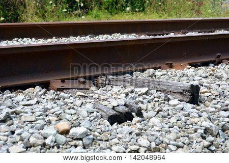 Rail road ties crumbling under rail lines