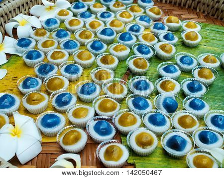 Local traditional sweet dessert (Bald candy or Hua lan) made from glutinous rice flour or sticky rice flour coconut milk and green beans.