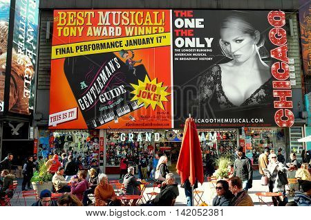 New York City - November 15 2015: Huge billboards advertising hit Broadway musicals A Gentleman;s Guide and Chicago in Times Square *