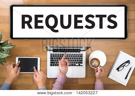 REQUESTS Two Businessman working at office desk and using a digital touch screen tablet and use computer top view