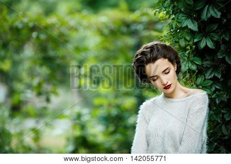 Young Vintage Style Woman Posing In A Vineyard