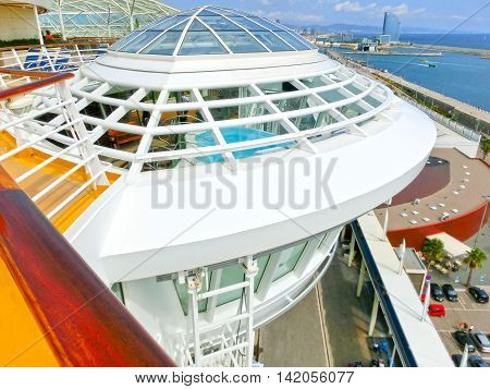 Barselona, Spaine - September 06, 2015: The cruise ship Allure of the Seas, The Royal Caribbean International. The interior view of the ship - jacuzzi pool overhanging the sea