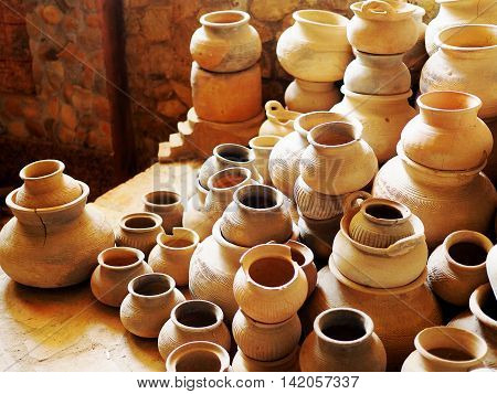 Set of earthenware pottery brown ceramic handmade of clay fired to a porous state. (selective focus)