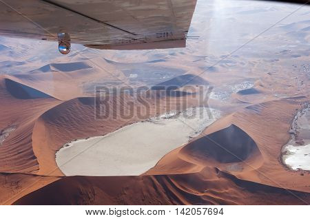 Flying over the Dead Vlei Sossusvlei in Namibia; Aerial view of the Dead Vlei Concept for traveling in Africa