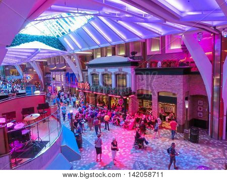 Barselona, Spaine - September 06, 2015: Royal Caribbean, Allure of the Seas sailing from Barselona on September 6 2015. The second largest passenger ship constructed behind sister ship Oasis of the Seas. Passengers walking inside the ship