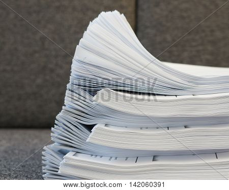 Stack Of Document On Sofa