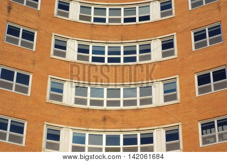 brick building round windows corner, office or hospital, orange wall