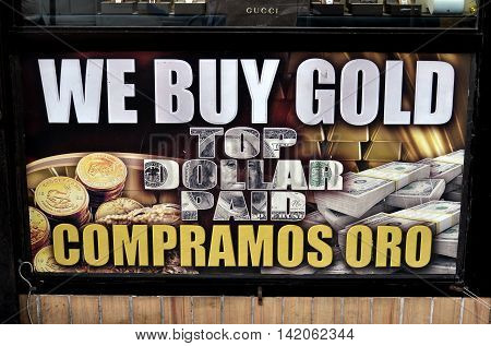 New York City - June 29 2015: We Buy Gold sign at a jewelry shop on Broadway in Hamilton Heights in English and Spanish