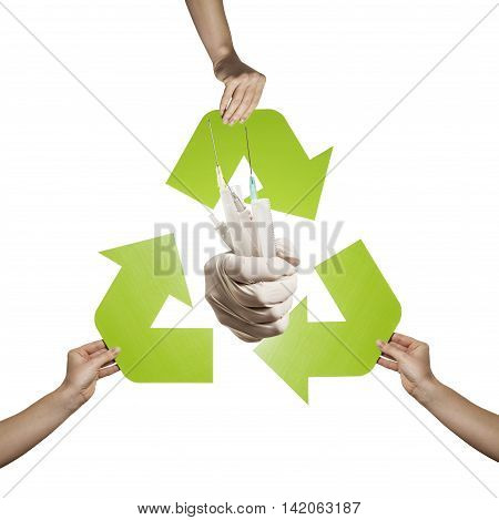 Medical waste recycling- hands holding recycling sign and infective waste studio shot isolated on white background