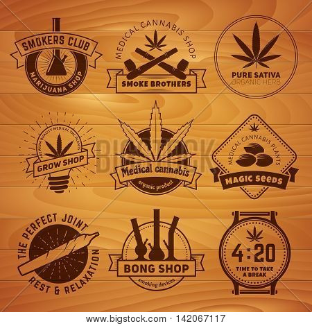 Set of vector marijuana smoking badges. Medical cannabis labels on a wooden background