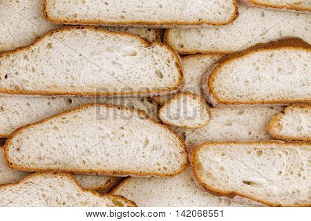 Wall of home made various sized bread slices as background for concept about food and carbohydrate nutrition. Includes copy space on each piece.