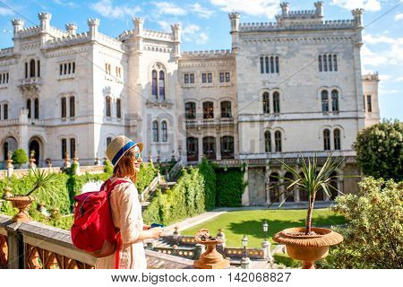 Young female traveler enjoying beautiful landscape near Miramare castle in northeastern Italy. Traveling in Italy