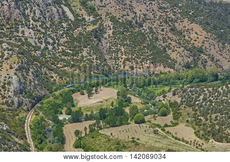 Aerial Photo Road Train mountain valley with rock and green